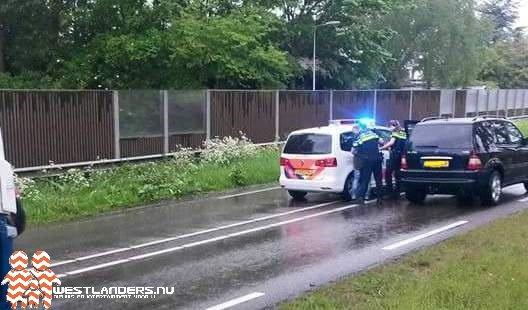 Ongeluk en file door aanhouding op Burgemeester Elsenweg