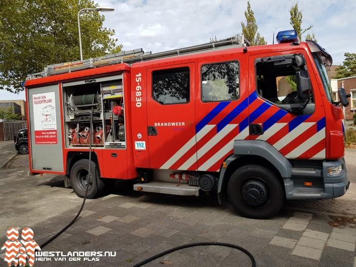 Middelbrand bij woning Irenestraat