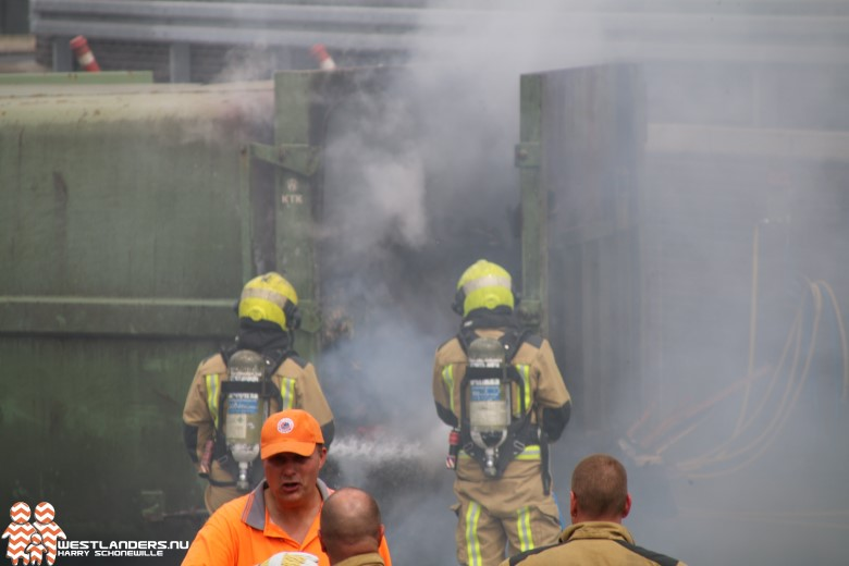 Brand in grote container met huisafval