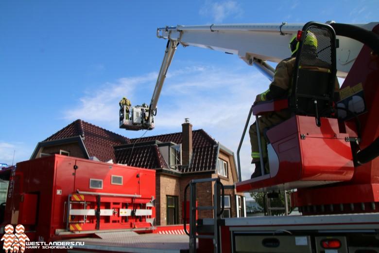 Korte dakbrand aan de Oostduinlaan
