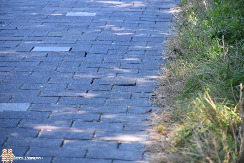 Fietspaden met losse tegels door aanhoudende droogte