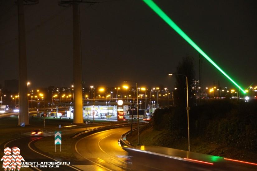 Groen laserlicht langs de rijksweg A4