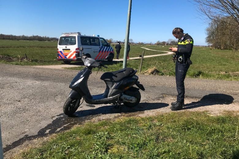 Nat pak voor scooterrijdster