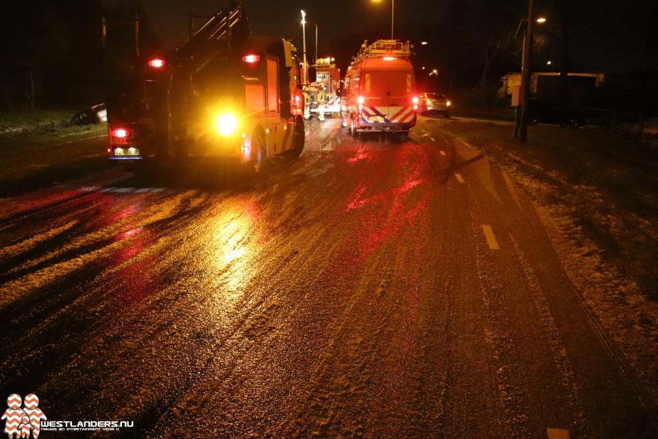 Auto te water aan de Rijksstraatweg