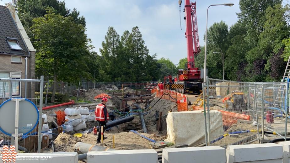 Nieuwe gasleidingen in de grond bij Hofstraat